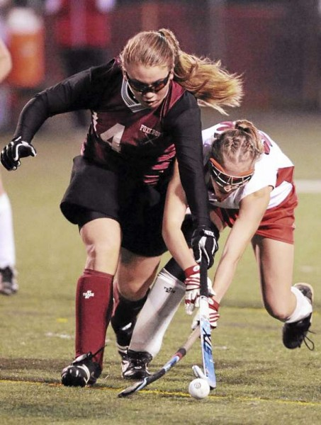Foxcroft's Rachel Keane, left, and Dexter's Crystal Cunningham, right,  battle for control of the ball during first-half action on Tuesday, October 26, 2010 at Hampden. Foxcroft won 1-0 in overtime to win the Eastern Maine Class C title. (Bangor Daily News/Kevin Bennett)
