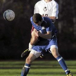 Madawaska's Gregoire faucher, foreground, and Orono's Alexander Introne collide as they attempt to control the ball during first-half action in a Class C quarterfinal on Thursday, October 28, 2010 in Orono. Orono won 2-1. (Bangor Daily News/Kevin Bennett)
