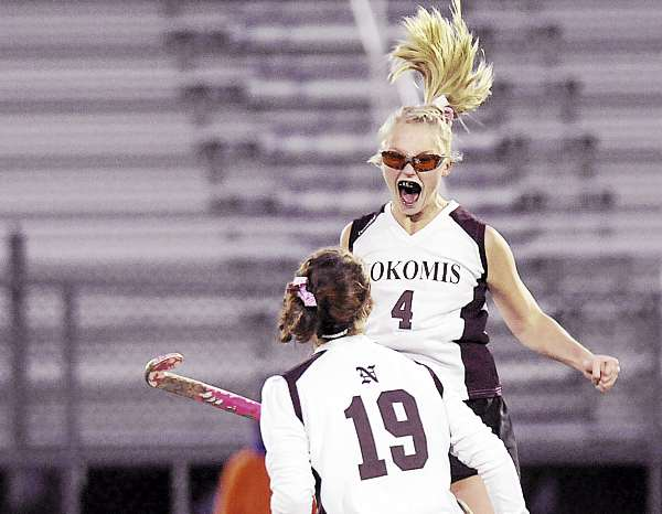Nokomis' Taylor Lovley (4) leaps with Leah Edmondson (19), celebrating their team's goal in the first half of their game in Orono, Saturday, Oct. 30, 2010. Bangor Daily News/Michael C. York