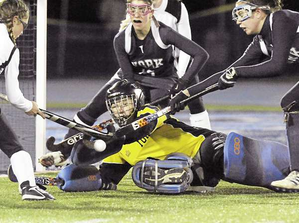 York High School goalie Amanda Kasbohm, Becka Sarson (25), and Michelle Potter (13) work to keep Nokomis' Abigail Donaldson from scoring on a rebound in the second half of their Class B State Championship Game in Orono, Maine, Saturday, Oct. 30, 2010. Nokomis won 2-0. Bangor Daily News/Michael C. York