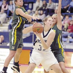 Husson's Brianna Hanscom , left, and Halley McGee, right, try to corral Maine's Ali Nalivaika (33) in the first half of their game at the University of Maine, Sunday, Oct. 31, 2010. Maine won 88-44. Bangor Daily News/Michael C. York