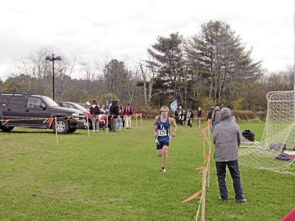 Silas Eastman of Fryeburg Academy won the state Class B boys cross country race with a time of 16 minutes, 2 seconds Saturday in Belfast. (Bangor Daily News/Ryan McLaughlin)