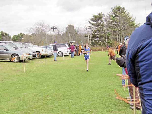 Washburn's Carsyn Koch runs to a first-place finish in the Class C state girls cross country championship in 19 minutes, 36 seconds. (Bangor Daily News/Ryan McLaughlin)