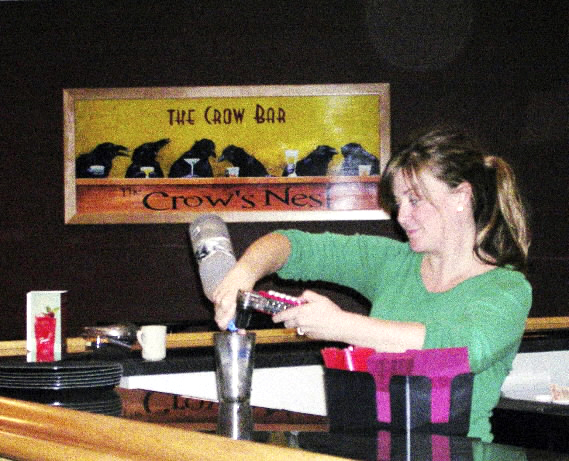 Melanie Perry, bar supervisor of The Crow Bar at The Crow's Nest in Presque Isle, prepares a drink on Thursday, Sept. 30. The Crow?s Nest, a restaurant and event center on Maysville Street in Presque Isle, will offer casual dining with menu selections to cater to all tastes. Selections will include seafood, pastas, poultry and red meats, with an emphasis on minimizing salts, sugars and fats where possible.   A special children's menu will contain fresh, healthy foods that will still appeal to younger palates. It will open to diners on Oct. 6. (BANGOR DAILY NEWS PHOTO BY JEN LYNDS)