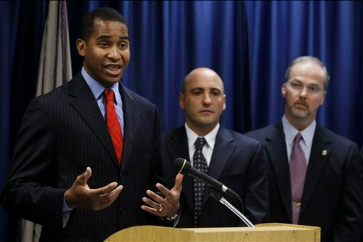 U.S. Attorney Zane David Memeger, from left, speaks as Nicholas DiGiulio from the Department of Health and Human Services and Thomas Doyle from the Food and Drug Administration look on during a news conference about Novartis Pharmaceuticals Corp., Thursday, Sept. 30, 2010, in Philadelphia. The U.S. Justice Department says the pharmaceutical maker has agreed to pay $422.5 million stemming from illegal marketing of the anti-epileptic drug Trileptal and five other drugs. (AP Photo/Matt Slocum)