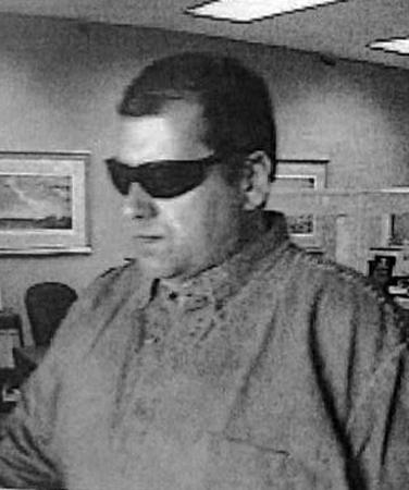 FBI-Boston has released these photos of the &quotBurly&quot Bandit, believed responsible for at least ten robberies in four states. This photo: North Attleboro, Mass., May 27, 2010. (FBI photo)
