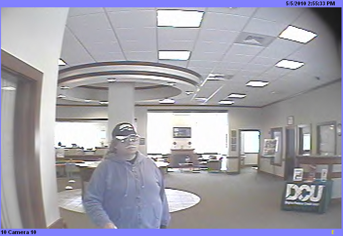 FBI-Boston has released these photos of the &quotBurly&quot Bandit, believed responsible for at least ten robberies in four states. This photo:  Tyngsboro, Mass., May 5, 2010. (FBI photo)