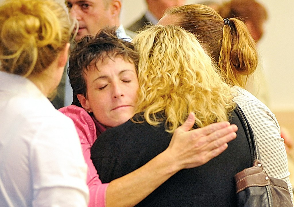 Kathy Ingraham (facing camera), mother of Holly Boutilier, hugs Susie Miller, a victim advocate with the Maine Attorney General's office, after a jury found Colin Koehler guilty at Penobscot Judicial Center late Friday afternoon, Oct. 1, 2010.  (Bangor Daily News/John Clarke Russ)