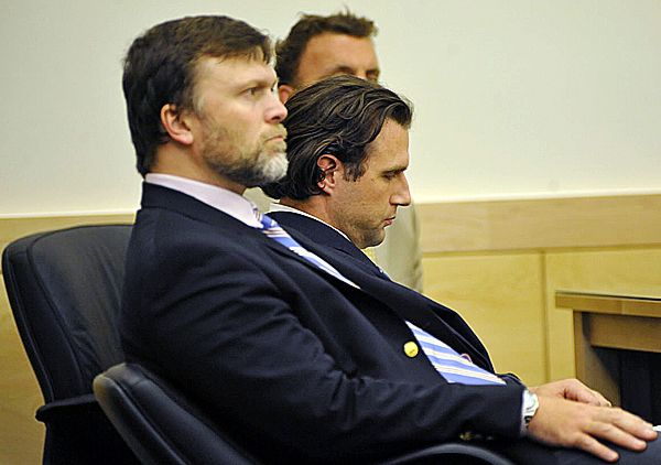 Seated between his defense attorneys, Richard Hartley (left) and Peter Cyr (behind), Colin Koehler, center, dropped his chin as the jury forewoman read a guilty verdict at Penobscot Judicial Center Friday, Oct. 1 ,2010.   BANGOR DAILY NEWS PHOTO BY JOHN CLARKE RUSS