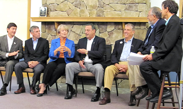 Democrat Libby Mitchell and Republican Paul LePage argue a point on Friday, Oct. 1, 2010 during a taped conversation for the cable television outdoors issues show &quotWildfire.&quot From left are independents Kevin Scott and Shawn Moody, Mitchell, LePage, independent Eliot Cutler and Wildfire hosts Harry Vanerweide and George Smith. (Bangor Daily News/Christopher Cousins)