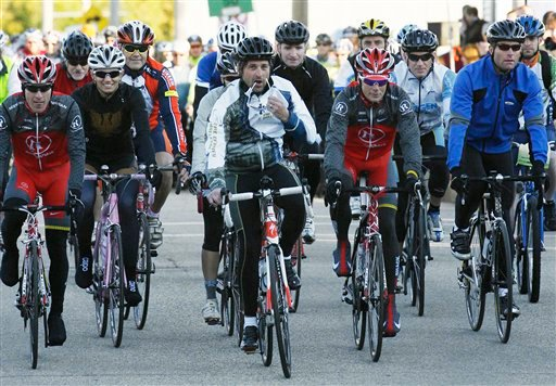 Actor Patrick Dempsey, center, begins biking in the second annual Dempsey Challenge, Sunday Oct. 3, 2010 in Lewiston, Maine. The two day event includes a 50-mile and 100-mile charity bicycle ride that benefits the Patrick Dempsey Center for Cancer Hope and Healing at Central Maine Medical Center in Lewiston. (AP Photo/Joel Page)