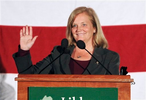 In this Sunday, September  26, 2010 photo, incumbent 1st District U. S. Rep.  Chellie Pingree waves to a crowd of supporters in S. Portland, Maine. Pingree will face Republican candidate Dean Scontras in the November election.(AP Photo/Pat Wellenbach)