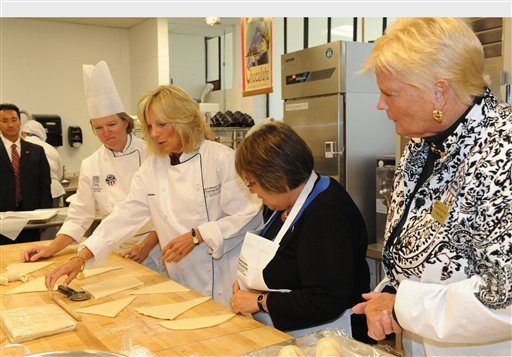 """Community college professor and advocate Dr. Jill Biden and and Dr. Martha Kanter, U.S. Department of Education undersecretary of vocational and adult education, second and third from left, joined Dr. Martha A. Smith, president of Anne Arundel Community College, right, in getting hands-on experience in """"Intermediate Bakery Production"""" from Chef Virginia Olson, left. Biden was visiting AACC in preparation for the first-ever White House Summit on Community Colleges she will host on Oct. 5.  (PRNewsFoto/Anne Arundel Community College)"""