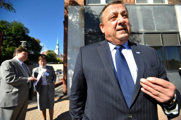 Standing in front of Willey Law Offices on Columbia Street, Republican gubernatorial candidate Paul LePage fields questions from the media while making  campaign stops in Bangor Tuesday, Oct. 5, 2010. Behind him are his deputy chief of staff John McGough (cq) and campaign supporter Cathy Watson of Pittsfield. (Bangor Daily News/John Clarke Russ)