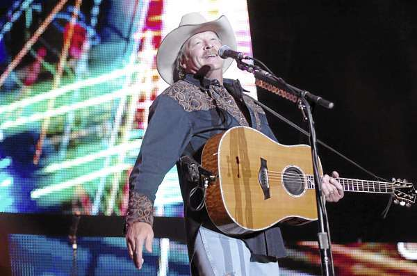 Alan Jackson greets thre crowd of more than 8,000 fans at the start of his show on Friday, which was part of the Bangor Waterfront Concert Series.   (BANGOR DAILY NEWS PHOTO BY BRIDGET BROWN)  CAPTION  Alan Jackson greets the crowd of more than 8,000 fans at the start of his show Friday, Sept. 10, 2010 which was part of the Bangor Waterfront Concert Series. (Bangor Daily News/Bridget Brown)