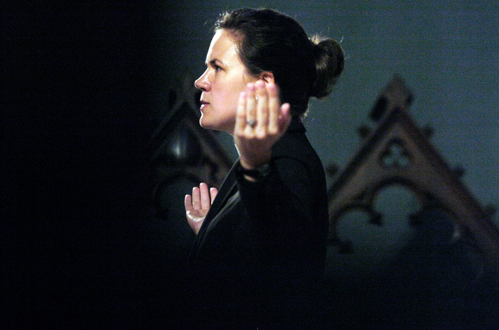 The Rev. Marguerite Steadman helps test acoustics of the public address system inside St. John's Episcopal Church on French Street in Bangor. Mother Steadman is the church's new rector.  (BANGOR DAILY NEWS PHOTO BY JOHN CLARKE RUSS)