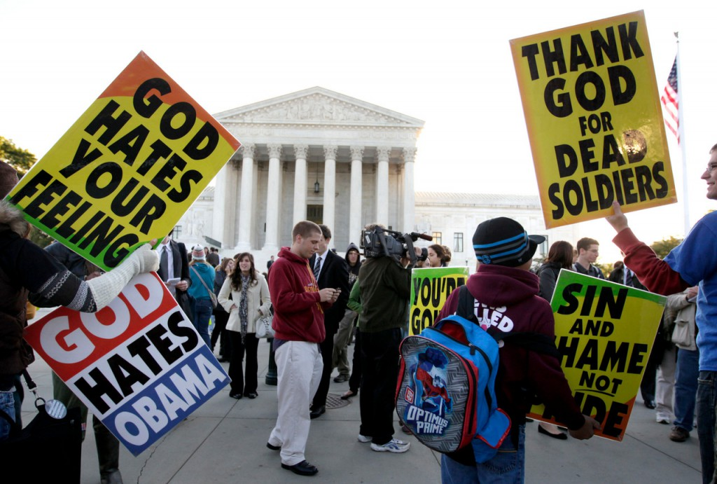 Members of the Westboro Baptist Church picket in front of the Supreme Court in Washington, Wednesday, Oct. 6, 2010. The court is hearing arguments Wednesday in the dispute between Albert Snyder of York, Pa., and members of the Westboro Baptist Church of Topeka, Kan. The case pits Snyder's right to grieve privately against the church members' right to say what they want, no matter how offensive. (AP Photo/Carolyn Kaster)