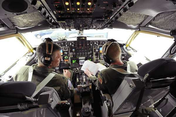 Lt. Col. Brent Stewart, left, of Brewer and Capt. Jason Tuck of Hampden do a pre-flight check list as they prepare to fly a KC-135 E on a training mission out of the Maine Air National Guard base in Bangor on Wednesday, October 6, 2010. (Bangor Daily News/Kevin Bennett)