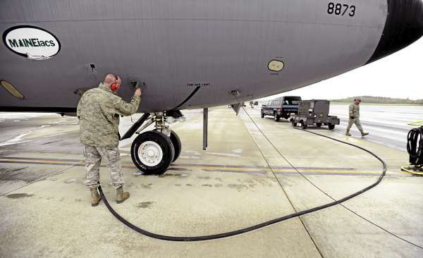 Maine Air National Guard Master Sgt. Tom Curley checks an oxygen gauge on a KC-135 E as the crew prepares for a training mission on Wednesday, October 6, 2010. (Bangor Daily News/Kevin Bennett)