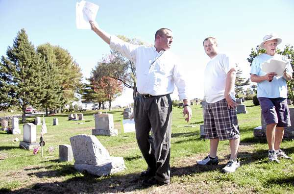 Mattanawcook Academy teacher Curt Ring lays out the remaining mapping to be done while student Darrell Savage, 18, of Lincoln and Lincoln Cemetery, Parks and Recreation Department Director Ron Weatherbee checks off work done at the West Broadway cemetery on Tuesday. A dozen students at the RSU 67 high school are mapping town cemeteries as part of their service learning class. BANGOR DAILY NEWS PHOTO BY NICK SAMBIDES JR.
