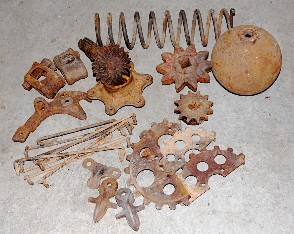 Gears, cogs, springs and other mysterious pieces from a farm machinery era gone by are all fodder for welding creativity. (Photo by Julia Bayly)