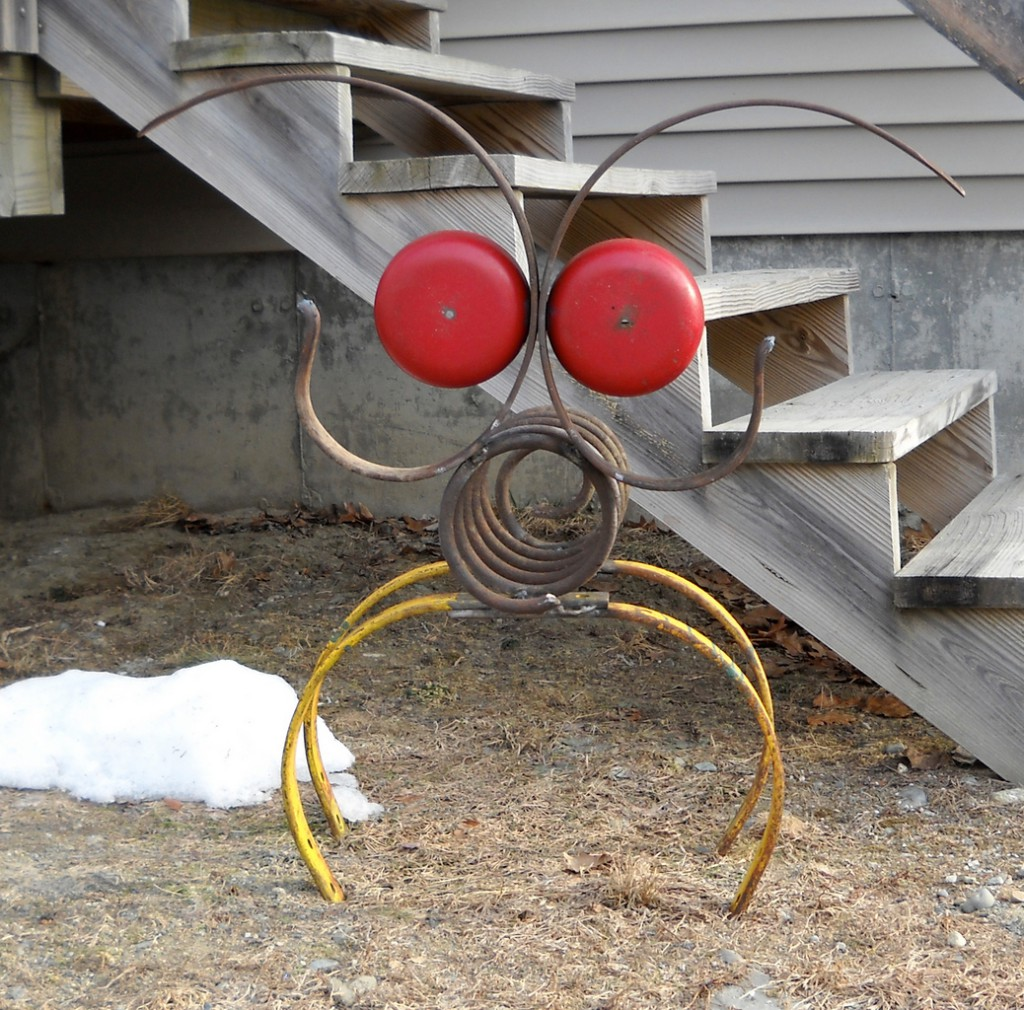 An old metal spring, discarded end caps from a fire alarm and other scavenged treasures went into creating this welded critter. (Photo by Julia Bayly)