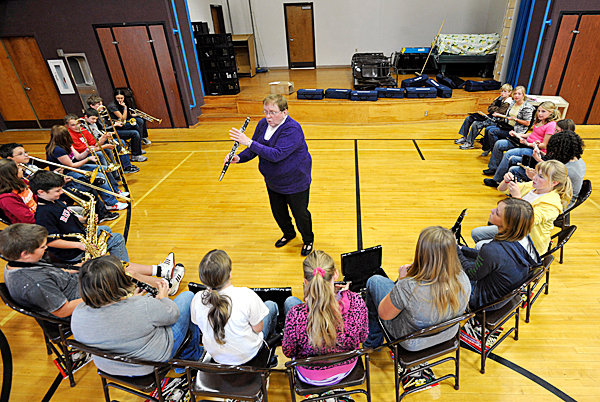 Harmony Elementary School music teacher Iris Fields (top, center) shows her clarinet section proper finger placement on their school-issue intruments Tuesday afternoon, Oct. 5, 2010. Thanks to Harmony's Patriarch's Club, VH1 Save the Music Foundation (New York) and the Oak Grove/Coburn Education Foundation (Maine) sixth through eighth graders at the school are learning to play various musical instruments. (Bangor Daily News/John Clarke Russ)