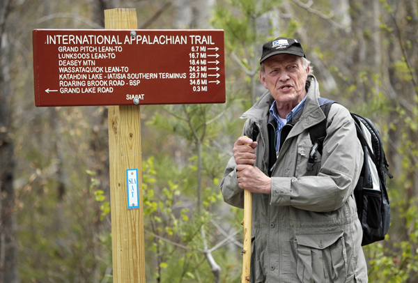 Richard Anderson, a former Maine conservation commissioner, whose efforts brought the International Appalachian Trail from concept to reality, speaks to a reporter on the trail in Township 5 Range 8 on May 7. A coalition of trail clubs is working to extend the trail by following the Appalachian mountain range into Europe. (AP Photo/Robert F. Bukaty)