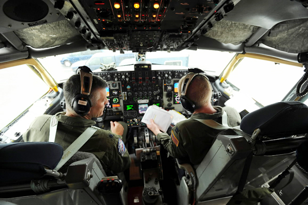 Lt. Col. Brent Stewart, left, of Brewer and Capt. Jason Tuck of Hampden do a pre-flight check list as they prepare to fly a KC-135 R on a training mission out of the Maine Air National Guard base in Bangor on Wednesday, October 6, 2010. (Bangor Daily News/Kevin Bennett)