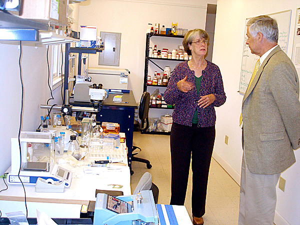 Dr. Brooke Lignon, president and CEO at Mitokine Biosciences in Hancock, explains the business' operation to Congressman Mike Michaud Thursday. Michaud toured two Hancock County businesses that are working with the Knowledge Transfer Alliance at the University of Maine which provides assistance to businesses. BANGOR DAILY NEWS PHOTO BY RICH HEWITT