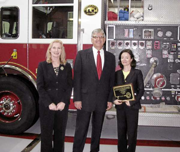 USDA Rural Development State Director Virginia Manuel, City of Brewer Deputy Mayor Joseph Ferris, and USDA Rural Development Deputy Administrator for RUS Jessica Zufolo.   Zufolo was awarded a ?Key to the City? Thursday, Oct. 7, 2010  for $30 million invested in Brewer?s water and wastewater infrastructure and Public Safety Building. (Photo courtesy of City of Brewer)