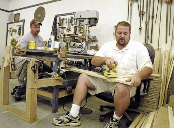 Ron Wallace and his cousin, 32-year-old Travis Webster of Passadumkeag [right], work in the Wallace Brothers Woodcrafters, LLC of Passadumkeag workshop on Friday. BANGOR DAILY NEWS PHOTO BY NICK SAMBIDES JR.