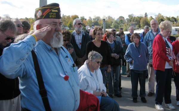 Herman Littlefield of the Northport Memorial VFW salutes Friday, Oct. 8 during the re-dedication ceremony for Armistice Bridge in Belfast, Maine. (Abigail Curtis/BDN)