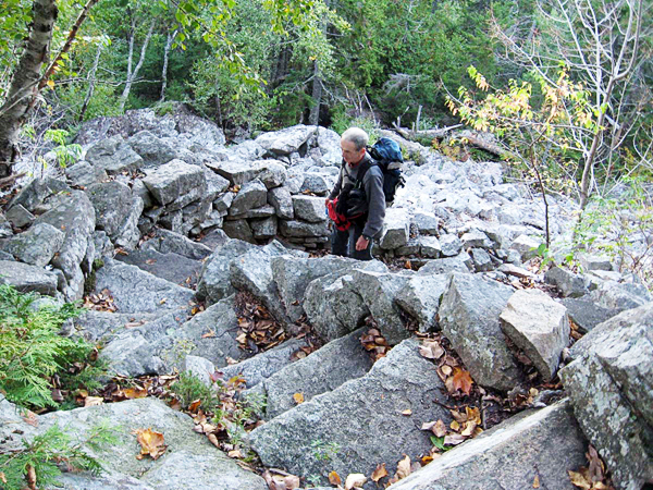 Brad Viles climbs the stone staircase on the Perpendicular Trail in Acadia National Park. The trail is a fall foliage favorite of hikers for the views of Long Pond and Beech Mountain. (Brad Viles photo)