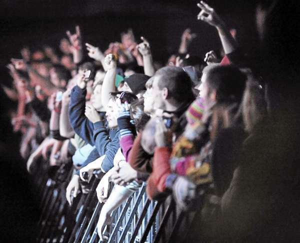 Rabid fans of the group Godsmack press against the barricade of the pit on front of the stage during the performance on Sunday, Oct. 10, 2010, in Bangor, Maine. (Bangor Daily News /Michael C. York)