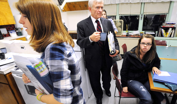 (BANGOR DAILY NEWS PHOTO BY GABOR DEGRE)CAPTIONHampden Academy mock trial team practiced opening statements then split up into groups to work on questioning witnesses with attorney coaches James McCarthy (center), Mark Beaumont and teacher Kathryn King. (Bangor Daily News/Gabor Degre)