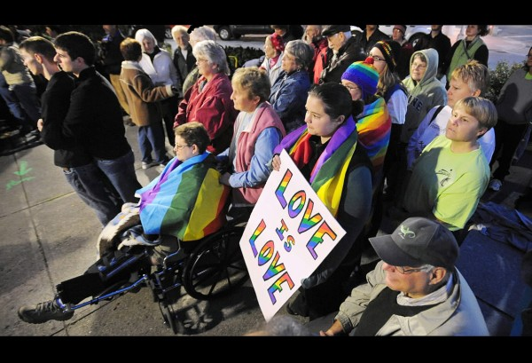 Abut 100 people gathered at West Market Square in Bangor to show their support for the gay, lesbian, bysexual and transgender community Monday on National Coming Out Day.   (Bangor Daily News/Gabor Degre)