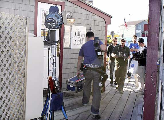 A film crew of more than a dozen people worked Tuesday to film a music video for country singer Kenny Chesney's song &quotSeven Days.&quot According to the video's producer, the video's release date is &quota ways down the road.&quot Video producer Don Lepore said the song is about the coast, lighthouses and the fall. Chesney might be in Port Clyde tomorrow, Lepore said.  BANGOR DAILY NEWS PHOTO BY HEATHER STEEVES
