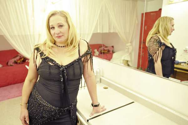 Diva's Gentlemen's Club owner Diane Cormier stands in the performers' changing area of her Bangor nightclub Wednesday afternoon, Oct. 13, 2010. Cormier said her landlord's eviction case against her was tossed out of court Tuesday. &quotThe truth always wins, &quot said Cormier Wednesday. &quot Exotic dancing needs to be protected. I haven't done anything wrong. Justice prevailed.&quot (Bangor Daily News/John Clarke Russ)