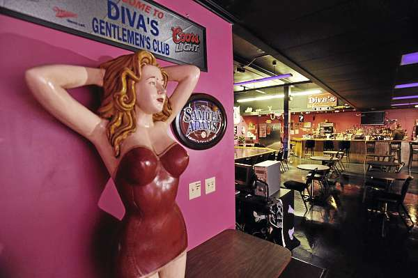 A dancer statue graces the entryway to the main stage room and bar of Diva's Gentlemen's Club in Bangor Wednesday afternoon, Oct. 13, 2010. Club owner Diane Cormier said her landlord's eviction case against her was tossed out of court Tuesday. &quotThe truth always wins, &quot said Cormier Wednesday. &quot Exotic dancing needs to be protected. I haven't done anything wrong. Justice prevailed.&quot (Bangor Daily News/John Clarke Russ)