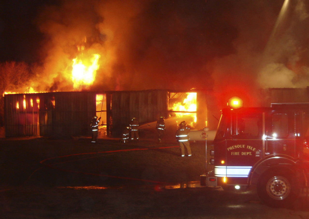 The Presque Isle Fire Department fought a fire at a  warehouse on Rice Street, responding jsut before 10 p.m. Friday. The building stored large rolls of paper and polyurethane for printing, also contained drums of ink, solvents and a large propane tank. ( PHOTO COURTESY OF THE PRESQUE ISLE FIRE DEPARTMENT)