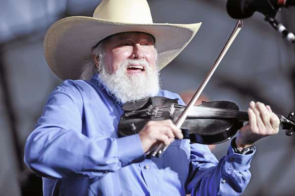 Charlie Daniels works his fiddle as he opens for Lynyrd Skynyrd on the Bangor Waterfront on Thursday evening.  (BANGOR DAILY NEWS PHOTO BY JOHN CLARKE RUSS)  CAPTION  Charlie Daniels. left, works his fiddle during his band's concert opener for Lynyrd Skynyrd on Bangor's Waterfront Thursday evening. (Bangor Daily news/John Clarke Russ)
