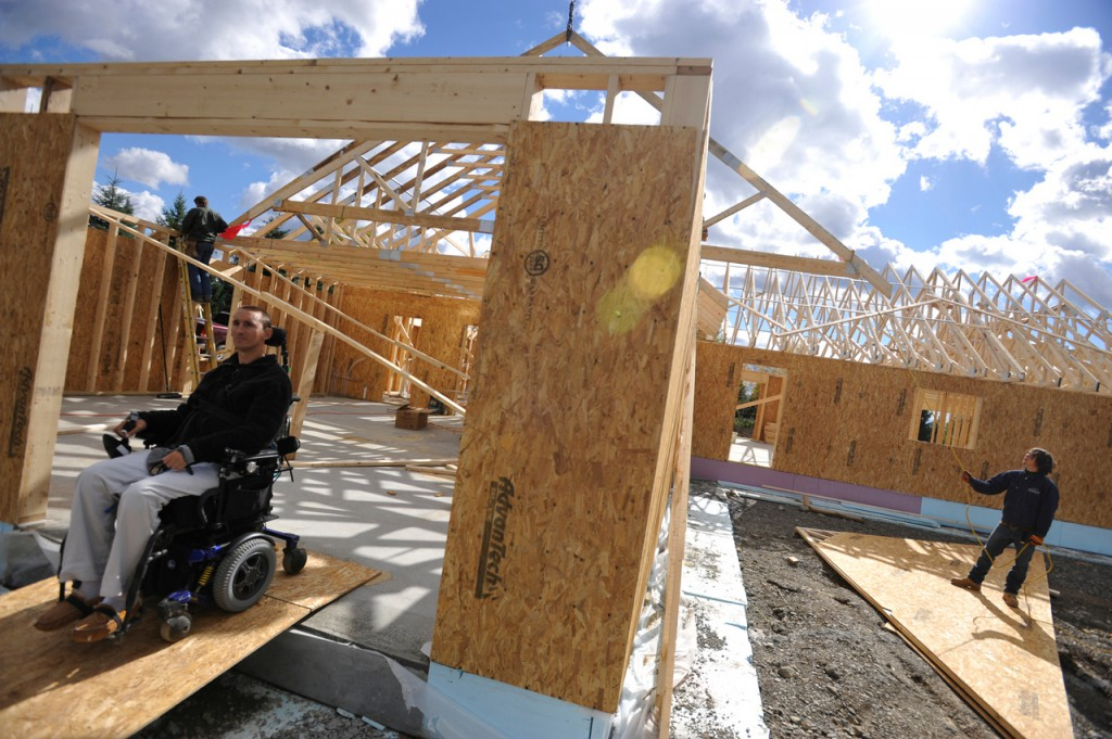 (BANGOR DAILY NEWS PHOTO BY JOHN CLARKE RUSS)  CAPTION  Checking up on the construction progress, Michael Chasse, 28,  exits the future home that he and his parents, Tom and Rhonda Chasse,  hope to move into by the end of this year. In March 2007, Chasse was paralyzed in a ski accident  in Park City, Utah. Now he and is parents are building an energy-efficient,  handicap-accessible home not far from their existing home in Presque Isle. (Bangor Daily News/John Clarke Russ)