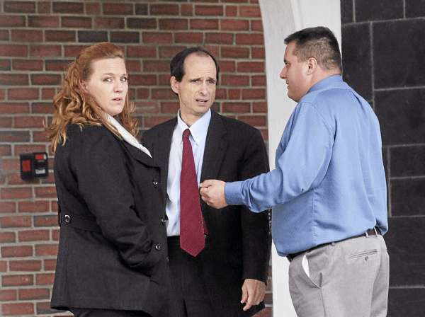 (BANGOR DAILY NEWS PHOTO BY GABOR DEGRE)  CAPTION  Lorraine (left) and Roger Morin (right) talk to their attorney A.J. Greif outside the Federal Court House in Bangor after the first day of their trial in Federal Court.  The Morin's sued Eastern Maine Medical Center after Lorraine was sent home from the hospital to deliver her dead son.  She told the court Monday that she has nightmares about delivering the dad fetus in the bathroom of her Millinocket home. (Bangor Daily News/Gabor Degre)
