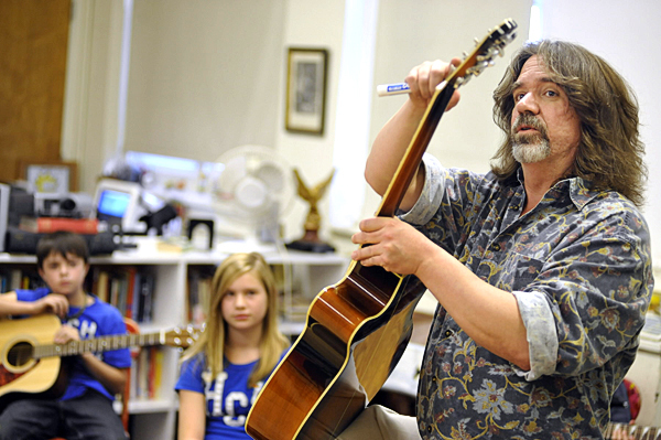 Guitar teacher Robert Donnelly (right) explains the parts of the guitar to a handful of Brewer Middle School fifth-graders during their first guitar class Wednesday afternoon. Behind him were students Matthew Bryant (left) and Mandy Cuskelly. Brewer Middle School and Brewer High School are offering rock'n' roll guitar classes, thanks to a grant from Stephen and Tabitha King.  (BANGOR DAILY NEWS PHOTO BY JOHN CLARKE RUSS)
