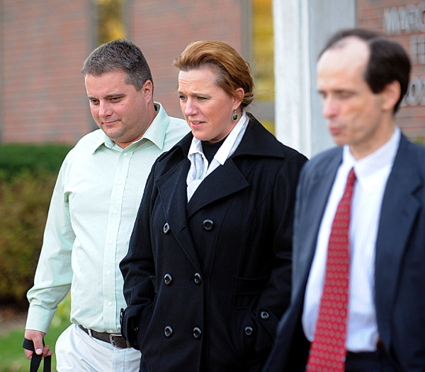 (BANGOR DAILY NEWS PHOTO BY GABOR DEGRE)CAPTIONRoger (left) and Lorraine Morin (center) leave the Federal Court with their attorney A.J. Greif after the second day of their trial in Federal Court.  The Morin's sued Eastern Maine Medical Center after Lorraine was sent home from the hospital to deliver her dead son.  She told the court Monday that she has nightmares about delivering the dad fetus in the bathroom of her Millinocket home. (Bangor Daily News/Gabor Degre)