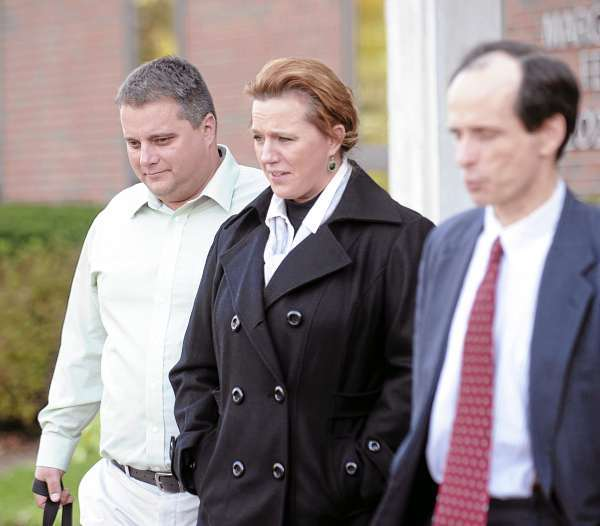 (BANGOR DAILY NEWS PHOTO BY GABOR DEGRE)  CAPTION  Roger (left) and Lorraine Morin (center) leave the Federal Court with their attorney A.J. Greif after the second day of their trial in Federal Court.  The Morin's sued Eastern Maine Medical Center after Lorraine was sent home from the hospital to deliver her dead son.  She told the court Monday that she has nightmares about delivering the dad fetus in the bathroom of her Millinocket home. (Bangor Daily News/Gabor Degre)
