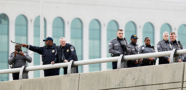 Law Enforcement Officers search for evidence along the  I-395 expressway adjacent to the Pentagon, Tuesday, Oct. 19, 2010. The Pentagon entrances were locked down early Tuesday after a report of possible shots fired near the building. (AP Photo/Pablo Martinez Monsivais)