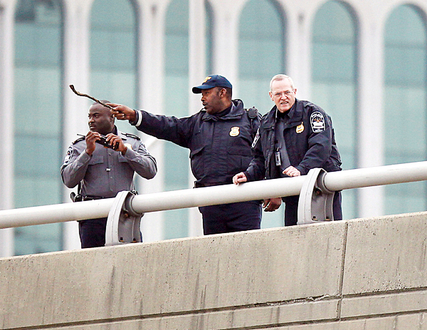 Pentagon law enforcement officers along the I-395 expressway adjacent to the Pentagon, Tuesday, Oct. 19, 2010. The Pentagon entrances were locked down early Tuesday after a report of possible shots fired near the building. (AP Photo/Pablo Martinez Monsivais)