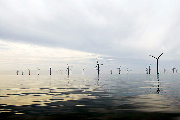 Visitors to Rehoboth Beach in Delaware soon may be greeted by more than sand dunes, gulls and a panoply of beach umbrellas. If offshore wind advocates have their way, 140 foot blades will be spinning in the ocean breeze such as in this photo of the Nysted Offshore Wind Farm in Denmark. (AP Photo/ Bluewater Wind)